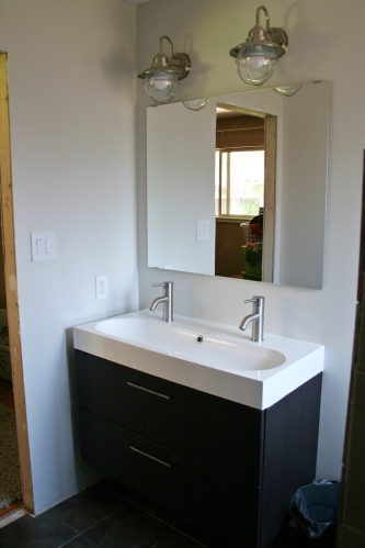 bathroom | The Letter K on fireplace against wall, cabinet against wall, dresser against wall, laminate flooring against wall, mirror against wall, wet bar against wall, desk against wall, windows against wall, counter top against wall,