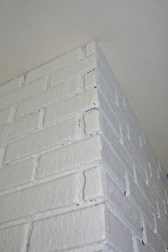 painted fireplace with cracks